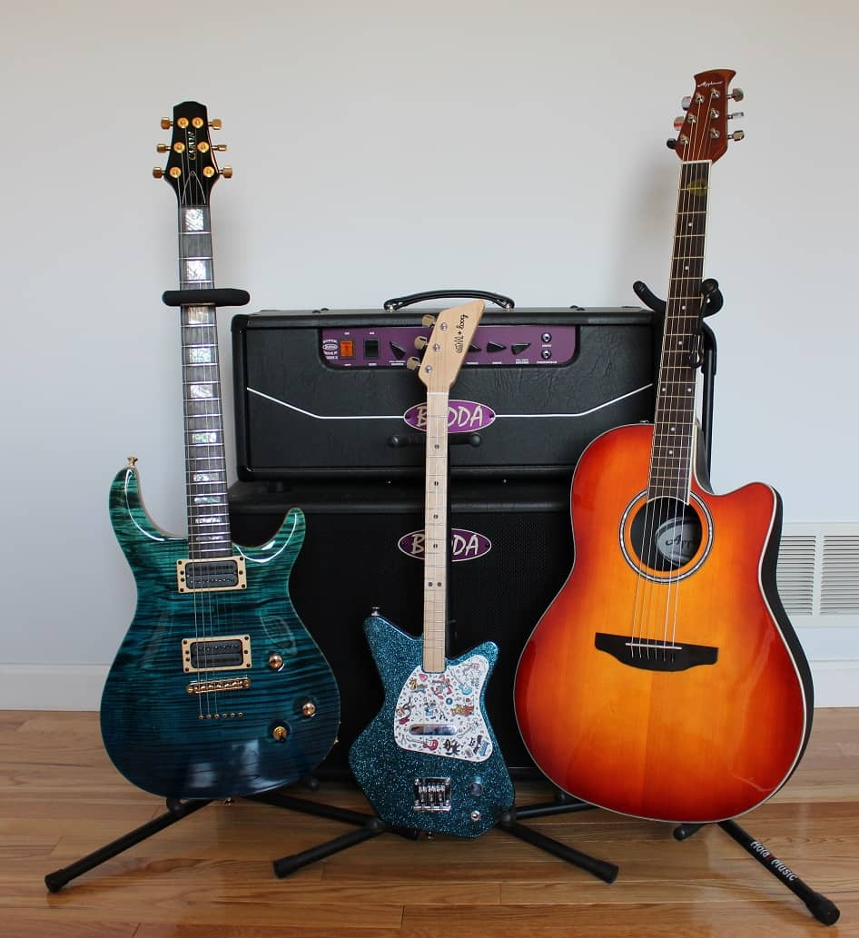 Loog guitar side by side with professional guitar rig