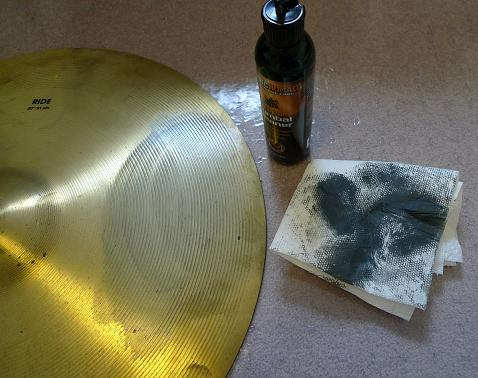 Cymbal being cleaned