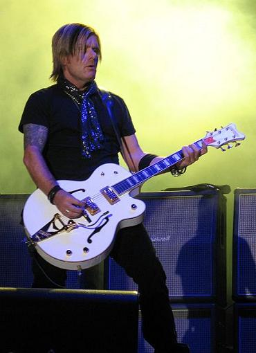 Billy Duffy on guitar
