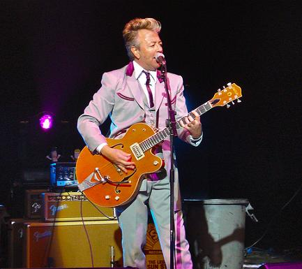 Brian Setzer playing guitar at concert