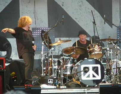 Chad Smith playing drums with Chickenfoot band