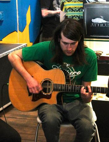 Chris Miller playing acoustic guitar