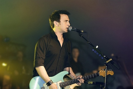 Colin James playing guitar