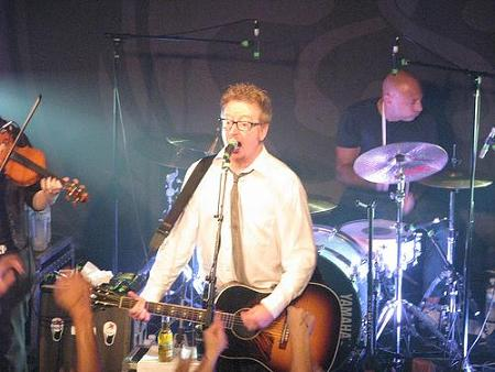 Dave on guitar with Flogging Molly