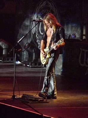 Doug playing guitar with Whitesnake