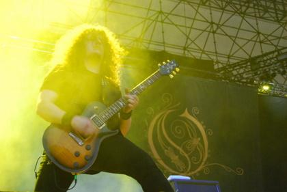 Fredrik Akesson playing guitar with Opeth