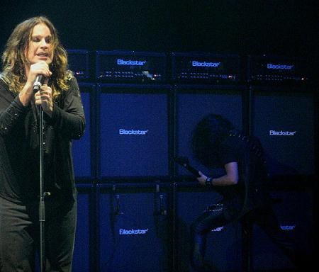 Gus G playing guitar with Ozzy