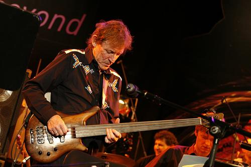 Jack Bruce playing bass live on stage