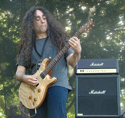 Jim Matheos playing guitar on stage