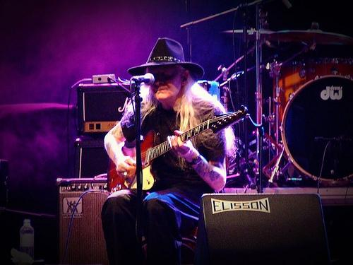 Johnny Winter playing guitar at concert