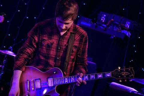 Max Helyer playing guitar