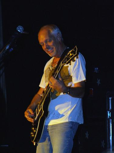 Peter Frampton playing guitar on stage