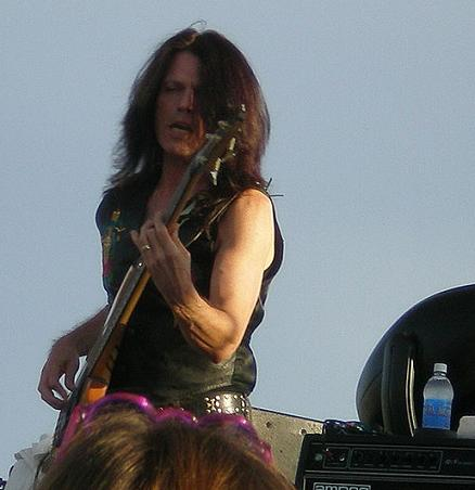 Rudy playing bass guitar