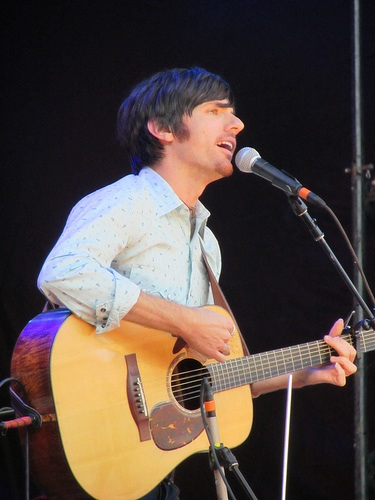 Seth Avett playing acoustic guitar