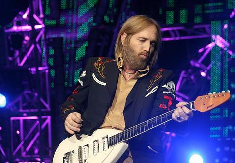 Tom Petty playing guitar live