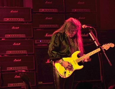 Yngwie playing Fender strat guitar live on stage